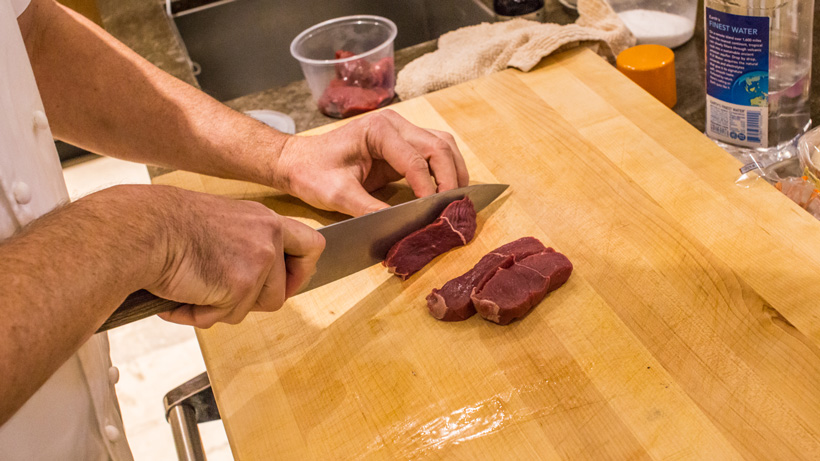 Cutting the elk meat