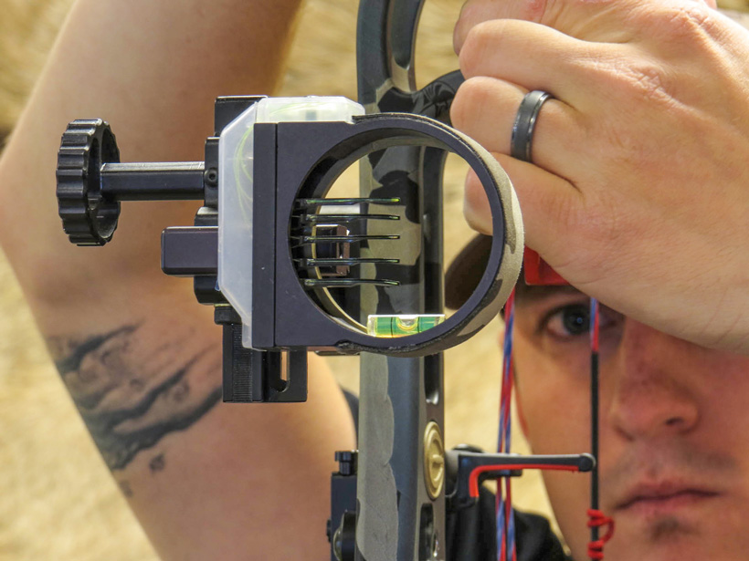 Dave Barnett checking axis levels on a bow sight