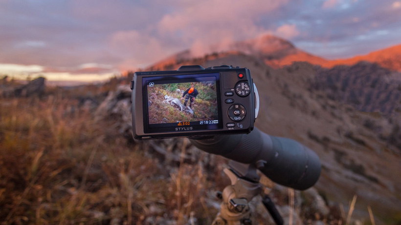 Digiscoping a mule deer kill with an angled Vortex spotting scope