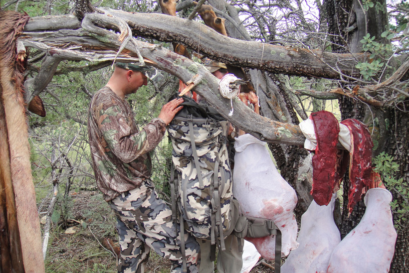 Jay Scott hanging and packing elk meat