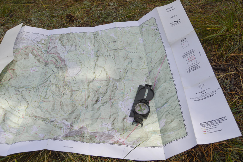 Navigating with a compass and a topographic map