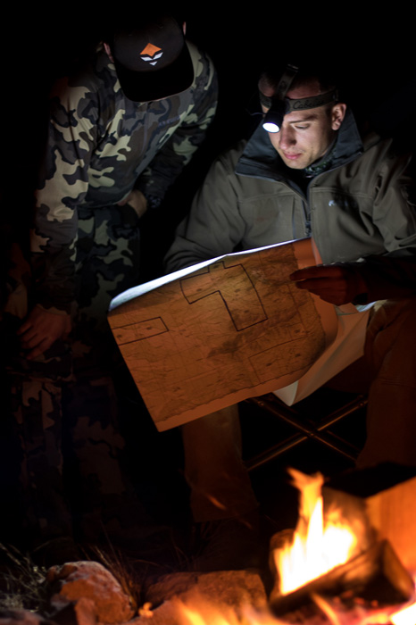 Studying maps for Coues deer hunting